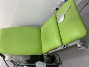 treatment couch with gynaecological stirrups